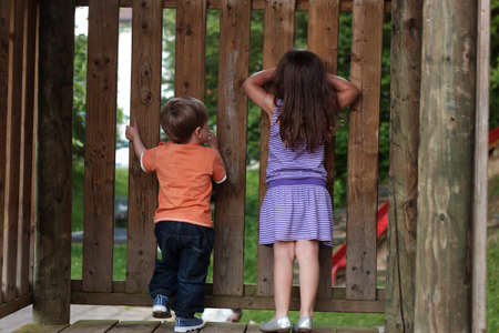 hide and seek: boy and girl playing hide and seek Stock Photo
