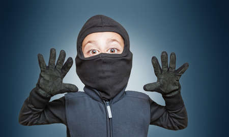 illegally: Surprised comic burglar stopped and take his hands up Stock Photo