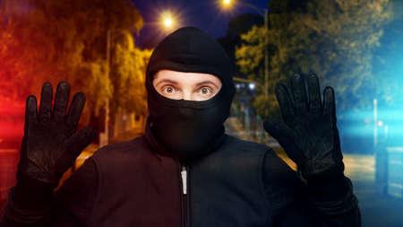 Surprised burglar stopped Stockfoto