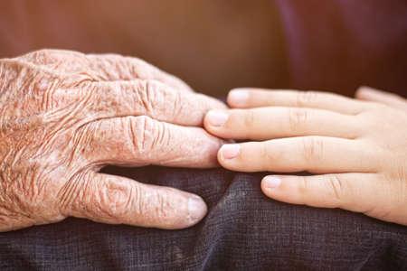 nephew touching grandfather \\\\ \\ \ 's hand