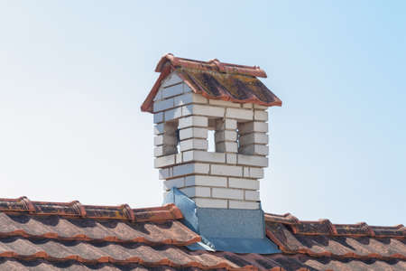 close up chimney: Close up chimney like a littl house on the roof Stock Photo