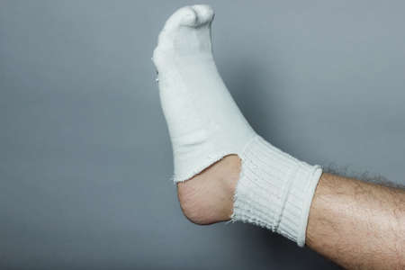 plantar: straight leg with a big hole in the sock