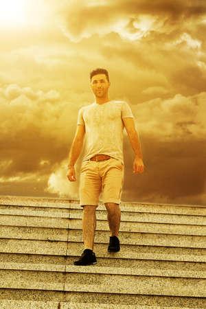 downstairs: man walking downstairs in wonderful sunset light