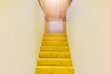 wooden stairs to attic shiny upward photo