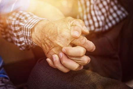 nephew holding strong grandfather's hand Foto de archivo