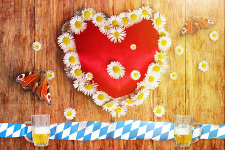 marguerites: greeting card of bavarian oktoberfest with heart and marguerites and butterflies on wooden board