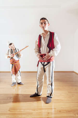 belly band: young boys in traditional albanian clothing