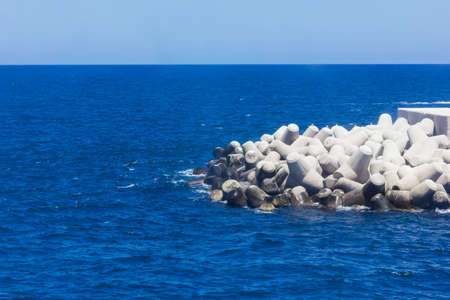 breakwaters: blue seaview with breakwaters of bari Stock Photo