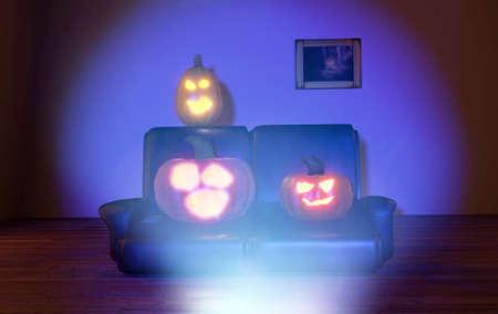 horrified: horrified pumpkins watching tv at night Stock Photo