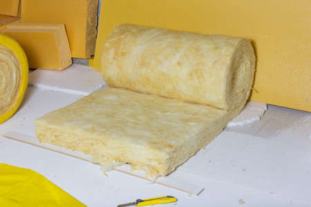 lagging: thermal insulation role in yellow package at attic background