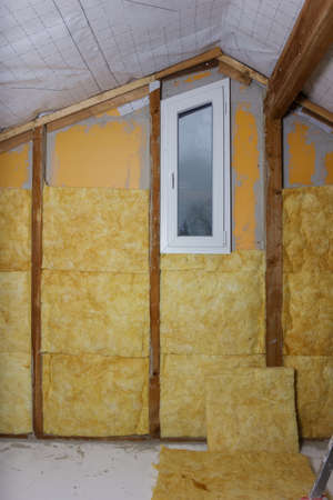 rockwool: termal insulation installing at the attic Stock Photo