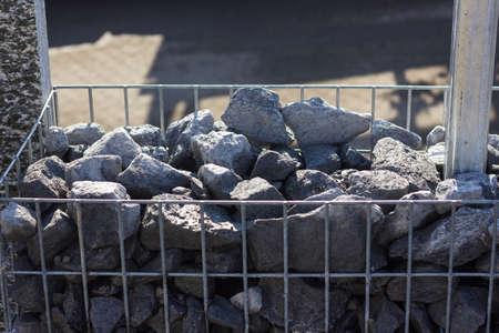 gabion mesh: granite gravel into metal mesh. Gabione garden wall