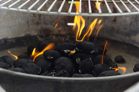 briquettes: black coal briquettes on fire
