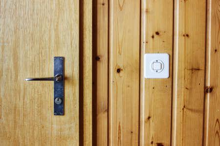 wall light: metal door handle with a wooden door