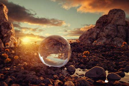 3d rendering of crystal ball on rocky terrain in the evening sunlight Stockfoto