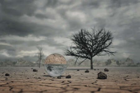 salinity: 3d rendering of crystal ball at dry soil landscape with trees and clouds Stock Photo