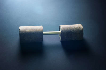 selfmade: selfmade rusty dumbbell on black background Stock Photo