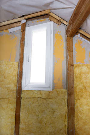 rockwool: termal insulation installing at the attic wall Stock Photo