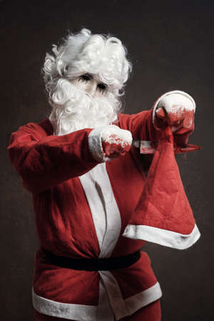 vengeful: Evil Santa Claus cut with bloody knife his christmas hat