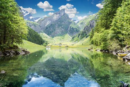 Tranquil scene of seealpsee lake reflecting the mountain of Alpstein, Appenzell, Switzerland Stock Photo