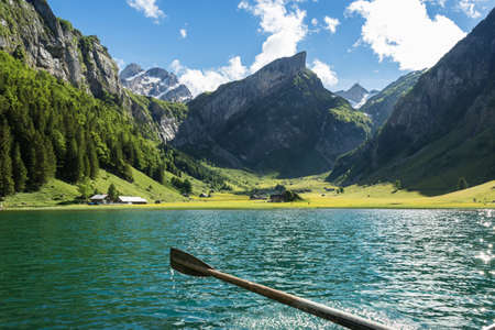 wooden rudder in front beautiful Seealpsee lake and Alpstein mountain in Appenzell, Switzerland