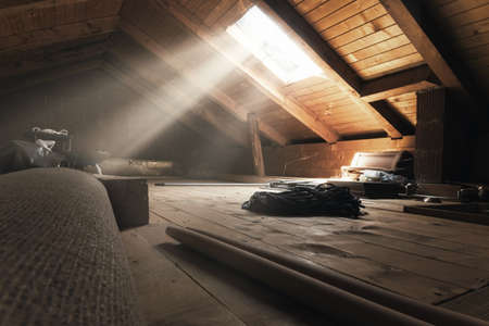brighten attic with light rays at window Stockfoto
