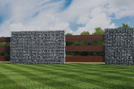 3d rendering of green garden with gabion wall and wooden planks Stock Photo
