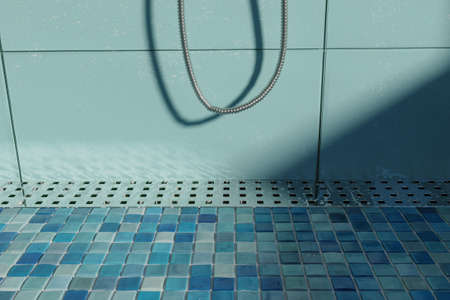 3d rendering of water drops on metal gutter on shower tray with mosaic tiles in the evening sunshine