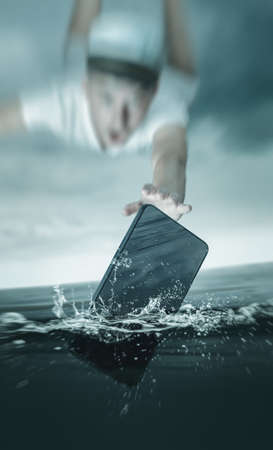young captain flying after smartphone which falling into sea water
