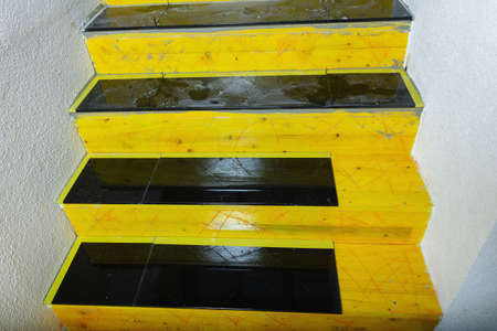 construction site of staircase covered with black natural stone tiles