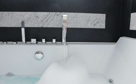 close up shot of modern bathroom with black and white granite stone