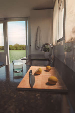 3d rendering of black natural stone work top of modern kitchen with lemons and knife on wooden board 写真素材