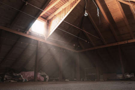 Brighten attic with wooden planks and light source at window Reklamní fotografie