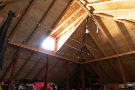 brighten attic with wooden planks and light source at window