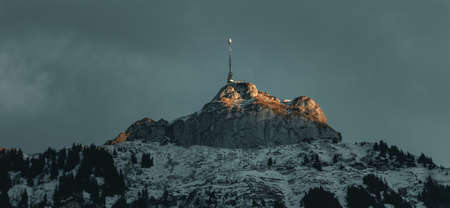 Peak of mountain Hoher Kasten lighted by the evening sun, Appenzell, Switzerland