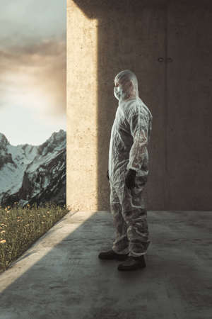 man in protective suit want to go outside and watching to the beautiful spring meadow
