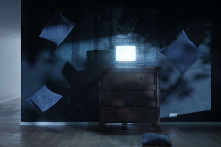 3d rendering of a haunted room with an old television and bright screen. Surrounded by flying pillows