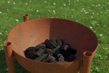 3d rendering of rusty fire bowl grill filled with charcoals