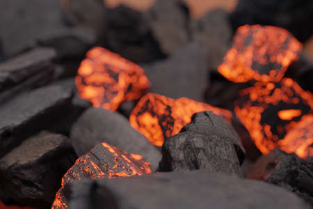 3d rendering of black and glowing charcoals in a close-up shot