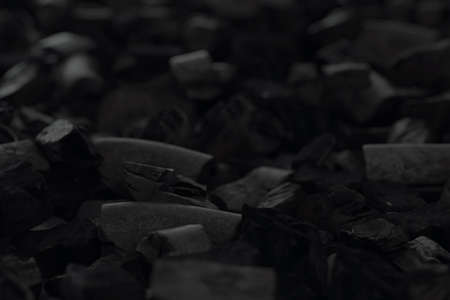3d rendering of charcoals laying on floor. Selective focus