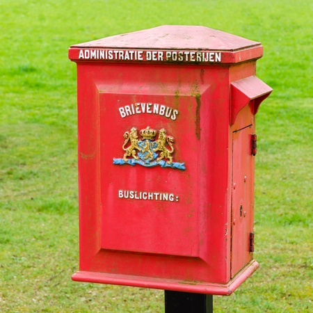 postoffice: A Dutch old red metal postbox Stock Photo