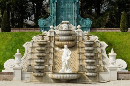 Cascading fountain with statue in the palace garden of Het Loo, Apeldoorn, The Netherlands