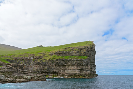 Steep cliff near the village of Gjogv on the island of Eysturoy, Faroe Islands, Denmark