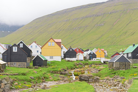 Picturesque village of Gjogv with typically colourful houses and the smaal creek on the island of Eysturoy, Faroe Islands, Denmark