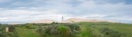 Panorama of the sandy dunes with the abandoned lighthouse of Rubjerg Knude, Denmark.