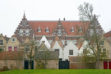 View on the Statenschool in Dordrecht with 17th century houses in front; built in 1913 in the neo-dutch Renaissance style