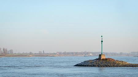 緑の夕日でワール川にビーコン 写真素材