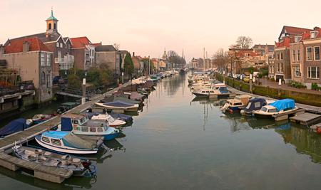 View on the new yacht harbor (the Wijnhaven) in Dordrecht in the evening sun Imagens