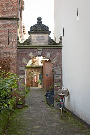 Bicycle parked at narrow street in Deventer, a typical Dutch scene