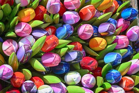 Bunch of colorful wooden artificial tulips